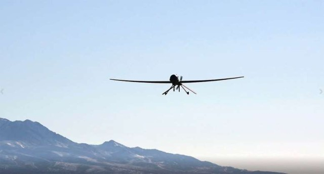 Warrior unmanned aerial system flying over Dugway Proving Ground and the adjacent Air Force Utah Test and Training Range. Together, they cover 2.2 million acres of arid, remote land.