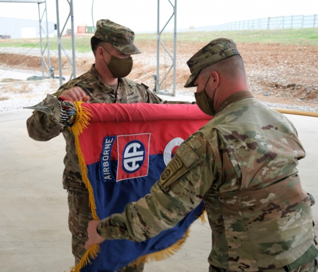 2nd Brigade Combat Team, 82nd Airborne Division's Brigade Commander, Col. Phillip Kiniery III, case the brigade colors signifying the completion of their responsibilities for Combined Joint Task Force - Operation Inherent Resolve during a transfer of authority ceremony at Erbil Air Base, Iraq, Jan. 31, 2021.