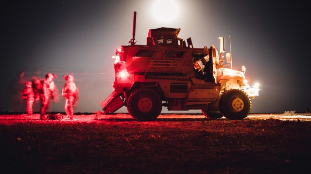 U.S. Soldiers assigned to the 2nd Battalion, 508th Parachute Infantry Regiment (TF West), 2nd Brigade, 82nd Airborne Division, exit a MRAP-All Terrain Vehicle (M-ATV) at Al Asad Air Base, Iraq, July 30, 2020. The 2nd Brigade is deployed to Iraq in support of Combined Joint Task Force-Operation Inherent Resolve. (U.S. Army photo by Spc. Khalil Jenkins)