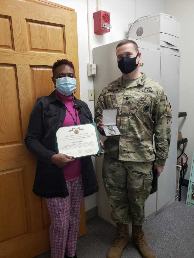 Lieutenant Colonel Andrew Henderson, Natick Soldier Systems Center Commander, presented Darlene Robinson, Equal Employment Opportunity Officer, her farewell award. Robinson accepted a position with Army Cyber Command.