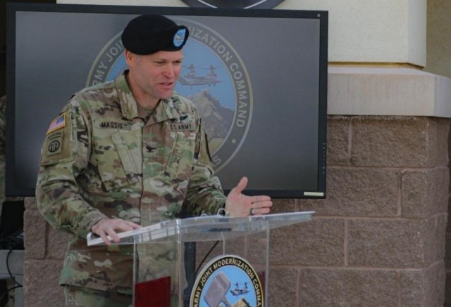 Col. Tobin Magsig speaks during Joint Modernization Command's change of command ceremony on June 15 in front of its headquarters on Fort Bliss, Texas. Magsig, now the JMC commander, said the Army is ambitiously expanding efforts to develop and integrate joint force technologies needed in future warfare as part of Project Convergence during a virtual event Feb. 9, 2021.