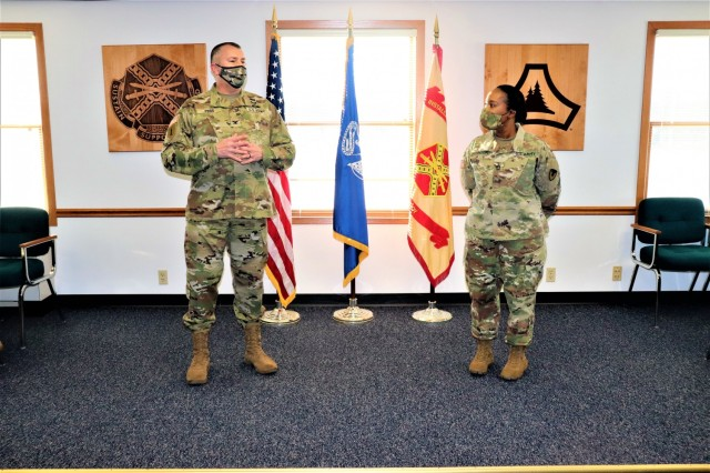 Fort McCoy Garrison Commander Col. Michael D. Poss prepares to present Master Sgt. Cynthia P. Johnson with an Army Meritorious Service Medal on Jan. 22, 2021, at the garrison headquarters building at Fort McCoy, Wis. Johnson earned the medal for meritorious service with Fort McCoy Garrison between 2018 and 2021. (U.S. Army Photo by Scott T. Sturkol, Public Affairs Office, Fort McCoy, Wis.)