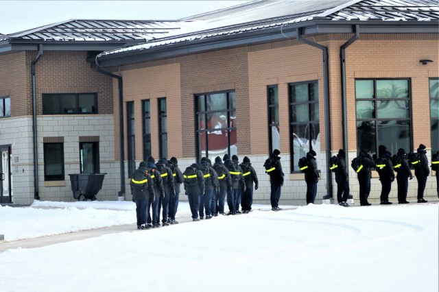 "U.S. Navy recruits walk to a dining facility Jan. 28, 2021, at Fort McCoy, Wis. The Navy's Recruit Training Command (RTC) of Great Lakes, Ill., worked with the Army in 2020 at Fort McCoy so the post could serve as a restriction-of-movement (ROM) site for Navy recruits prior to entering basic training. Additional personnel support from the Navy's Great Lakes, Ill., Millington, Tenn., and Washington, D.C., sites deployed to McCoy to assist RTC in conducting the initial 14-day ROM to help reduce the risk of bringing the coronavirus to RTC should any individual be infected. More than 40,000 recruits train annually at the Navy's only boot camp. This is also the first time Fort McCoy has supported the Navy in this capacity. Fort McCoy's motto is to be the ""Total Force Training Center."" (U.S. Army Photo by Scott T. Sturkol, Public Affairs Office, Fort McCoy, Wis.)"