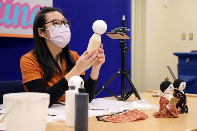"Sabrina Tsai, manager of the Camp Zama Arts and Crafts Center, teaches a virtual class on how to make Japanese ""Hinamatsuri"" dolls at the Camp Zama Library, Camp Zama, Japan, Feb. 9."