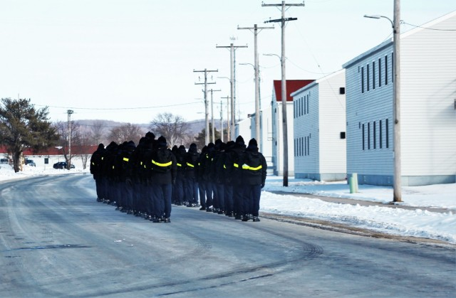 "U.S. Navy recruits walk on the cantonment area Jan. 28, 2021, at Fort McCoy, Wis. The Navy's Recruit Training Command (RTC) of Great Lakes, Ill., worked with the Army in 2020 at Fort McCoy so the post could serve as a restriction-of-movement (ROM) site for Navy recruits prior to entering basic training. Additional personnel support from the Navy's Great Lakes, Ill., Millington, Tenn., and Washington, D.C., sites deployed to McCoy to assist RTC in conducting the initial 14-day ROM to help reduce the risk of bringing the coronavirus to RTC should any individual be infected. More than 40,000 recruits train annually at the Navy's only boot camp. This is also the first time Fort McCoy has supported the Navy in this capacity. Fort McCoy's motto is to be the ""Total Force Training Center."" (U.S. Army Photo by Scott T. Sturkol, Public Affairs Office, Fort McCoy, Wis.)"