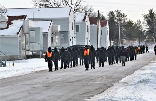 "U.S. Navy recruits walk on the cantonment area Jan. 28, 2021, at Fort McCoy, Wis. The Navy's Recruit Training Command (RTC) of Great Lakes, Ill., worked with the Army at Fort McCoy so the post could serve as a restriction-of-movement (ROM) site for Navy recruits prior to entering basic training. Additional personnel support from the Navy's Great Lakes, Ill., Millington, Tenn., and Washington, D.C., sites deployed to McCoy to assist RTC in conducting the initial 14-day ROM to help reduce the risk of bringing the coronavirus to RTC should any individual be infected. More than 40,000 recruits train annually at the Navy's only boot camp. This is also the first time Fort McCoy has supported the Navy in this capacity. Fort McCoy's motto is to be the ""Total Force Training Center."" (U.S. Army Photo by Scott T. Sturkol, Public Affairs Office, Fort McCoy, Wis.)"