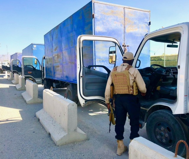 A contractor conducts vehicle checks as part of Army Contracting Command-Rock Island's Private Security Contract at Bagram Air Field (BAF), Afghanistan. (Courtesy photo)