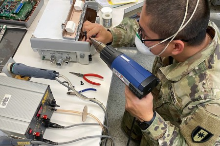 Spc. Nguyenquanghu Phan repairs a ventilator at the U.S. Army Medical Materiel Agency's Medical Maintenance Operations Division at Tobyhanna Army Depot in Pennsylvania during a recent deployment. Phan and eight other Soldiers from the 6th Medical Logistics Management Center at Fort Detrick, Maryland, deployed to USAMMA's three MMODs to supplement the workforce during the COVID-19 response as each depot saw spikes in work order requests. (U.S. Army photo by Staff Sgt. Derek Presto)