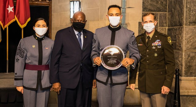(From left to right) Class of 2021 Cadet Riley McGinnis, U.S. Military Academy 1965 graduate Joseph Anderson, Class of 2021 Cadet Markus Wright and the Commandant of Cadets Brig. Gen. Curtis Buzzard stand at attention as Wright receives an award for the obstacles he overcame throughout his tenure at West Point during the annual Henry O. Flipper Commemoration Dinner at the Cadet Mess Hall Feb. 4.