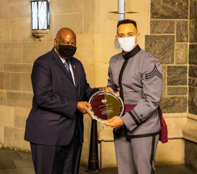 U.S. Military Academy 1965 graduate Joseph Anderson (left) presents the Henry O. Flipper Award to Class of 2021 Cadet Markus Wright (right) during the Flipper Award ceremony Feb. 4 at the Cadet Mess Hall. West Point held its annual Henry O. Flipper commemoration dinner to honor Flipper, the first African-American West Point graduate, and the award recipient who overcame many obstacles to succeed, which is the basis of the award, at the academy.