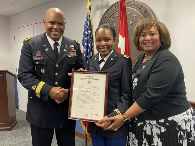 Lt. Gen. Leslie Smith, the Army's inspector general, swore in his daughter, 2nd Lt. Tori Smith, who is now attending medical school at Howard University to become an Army nurse. Also pictured is Smith's wife, Vanedra.