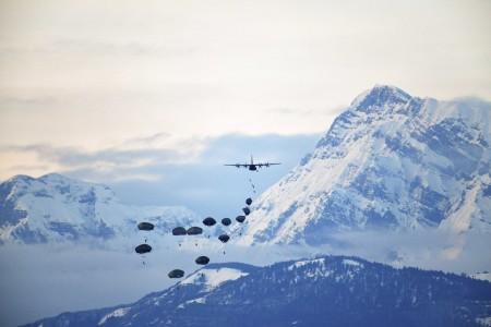 Soldiers conduct an airborne operation from an Air Force C-130 Hercules aircraft at Frida drop zone in Pordenone, Italy, Feb. 1, 2021.