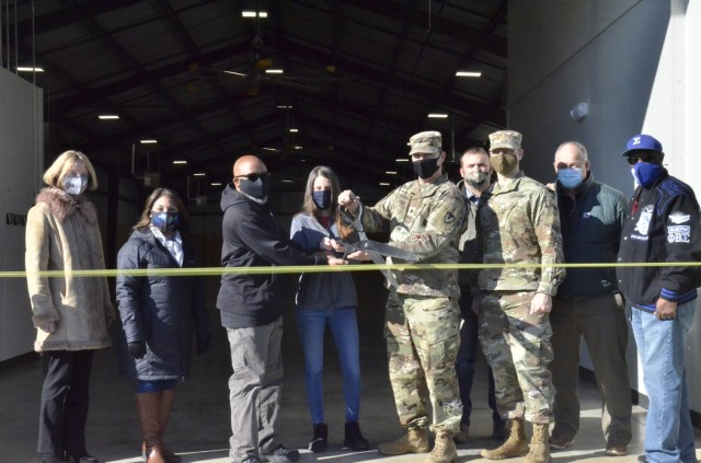 Members of Army Field Support Battalion-Campbell unveil a new individual chemical equipment facili-ty, or IceFAC, warehouse Feb. 5 that will house chemical protective equipment for the 101st Airborne Division (Air Assault).