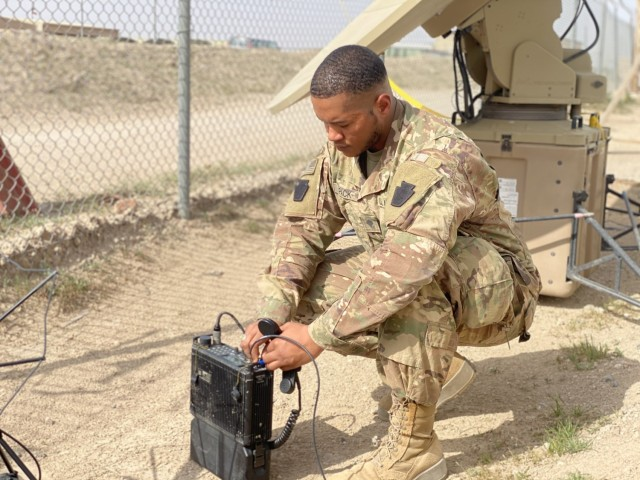 Spc. John Pack, deployed with the 1st Battalion, 137th Aviation Regiment, performs a radio check after setting up telecommunication equipment.  Spc. Pack is currently deployed in support of Operation INHERENT RESOLVE and Operation SPARTAN SHIELD.