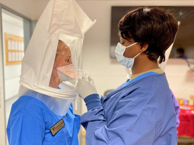 Army Sgt. Diatou Gueye (right), a 68E dental specialist assigned to the Vilseck Army Dental Clinic, recently completed a fast paced training and certification process in the proper fitting and wear of N95 masks. Her efforts will ensure all personnel assigned to the clinic are wearing protective masks correctly.
