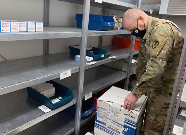 Maj. Race Dulin inspects incoming vaccine shipments at the U.S. Army Medical Materiel Center-Europe, which has been providing logistical support for the distribution of vaccine in response to the global COVID-19 pandemic. (U.S. Army photo by Holger Koelsch)