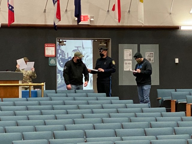 Soldiers and Civilians check in with the medical staff at Hunter Auditorium, before receiving the COVD-19 vaccine.