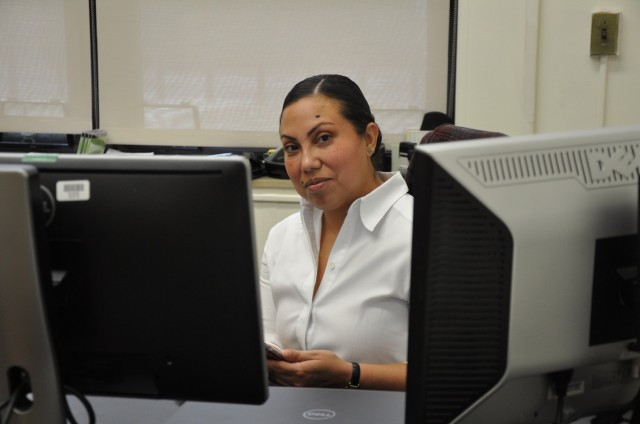 Monica Brooks, security manager, settles in to the new position at Natick Soldier Systems Center.