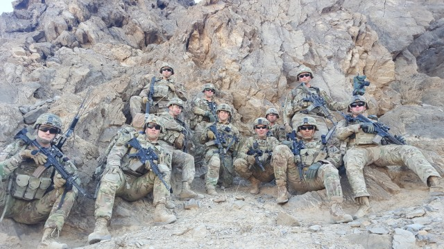"""FORT BENNING, Ga. – In Afghanistan in December 2018, Soldiers of 2nd Battalion, 14th Infantry Regiment (Golden Dragons), 10th Mountain Division, on a halt during a patrol in the Kandahar region. Among them is Command Sgt. Maj. Robert K. """"Rob"""" Fortenberry (fifth from right), who at the time served as senior enlisted leader with Train, Advise, Assist Command-South, or TAAC-South. Fortenberry, a veteran Infantryman who has also served as a drill sergeant, led troops in combat, and graduated from the U.S. Army's grueling Ranger School at age 45, is retiring after more than 30 years in uniform. Since 2019 he has served as senior enlisted leader at the U.S. Army Infantry School at Fort Benning, and relinquishes his responsibilities in a ceremony here Feb. 22.  (Photo courtesy of Command Sgt. Maj. Robert K. Fortenberry)"""
