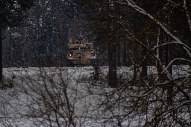 A Bradley from 1st Squadron 7th Cavalry Regiment reconnoiters an objective in support of a Fire Coordination Support Exercise at Grafenwoehr Training Area, Germany Feb. 9.
