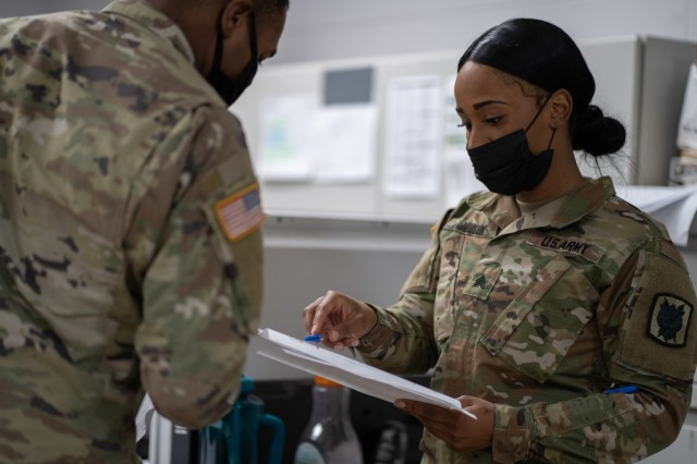 Sgt. Saleena Dodson, an automated logistical specialist assigned to 63rd Expeditionary Signal Battalion, 35th Theater Tactical Signal Brigade, reviews documents at Fort Stewart, Georgia, Feb. 16, 2021. Dodson earned her Ph.D in epidemiology from Temple University in Nov. 2020, while serving on active duty. (U.S. Army photo by Capt. Eric Messmer)