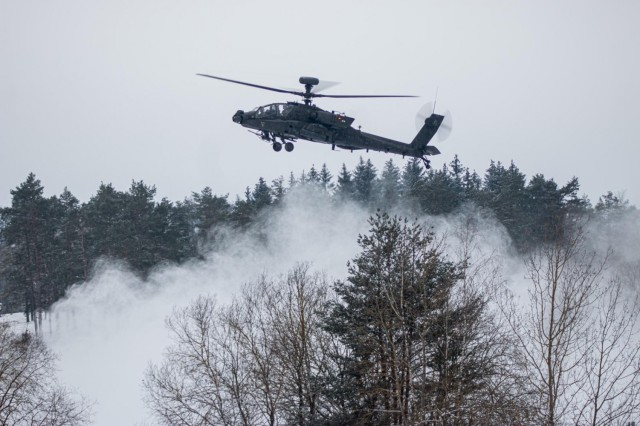 an AH-64 Apache from 1st Battalion, 101st Combat Aviation Brigade hovers as it waits to fire its weapons in support of a Fire Coordination Support Exercise at Grafenwoehr Training Area, Germany Feb. 9.