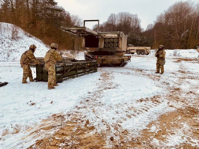 Soldiers from 1st Battalion, 142nd Field Artillery Brigade load a Multiple Launch Rocket System as it prepares to launch in support of a Fire Coordination Support Exercise at Grafenwoehr Training Area, Germany Feb. 9.