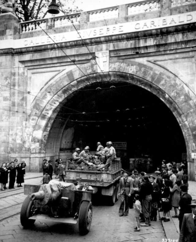 In the newly liberated city of Genoa, Italy, the 92nd Infantry Division troops enter the Galleria Guiseppe Garibaldi, April 27, 1945. (U.S. Army Photo)