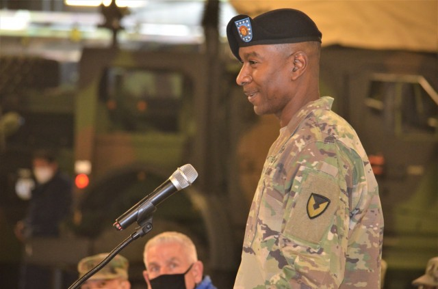 Command Sgt. Maj. Christopher J. Reaves, new command sergeant major of the 403rd AFSB, presents remarks to those in attendance and viewing remotely, during the brigade's change of responsibility ceremony at Camp Carroll, South Korea, Feb. 10.
