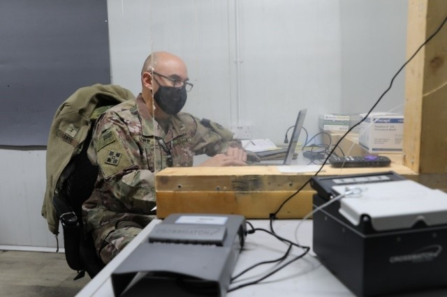 Chief Warrant Officer David Lente, who leads the Syrian Logistics Cell military intelligence team or S-2, at Erbil Air Base, Iraq, reviews a truck driver's record Feb. 5, 2021. Lente said if a driver is flagged, he then conducts a further review. (U.S. Army photo by Capt. Elizabeth A. Rogers)