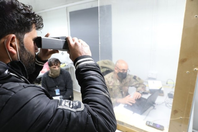 A truck driver undergoes an iris scan at Erbil Air Base, Iraq, Feb. 5, 2021 conducted by Chief Warrant Officer Lente, the officer in charge of the Syrian Logistics Cell military intelligence team or S-2. All drivers partake in the iris scan in addition to a fingerprint scan and a review of their record. (U.S. Army photo Capt. Elizabeth A. Rogers)