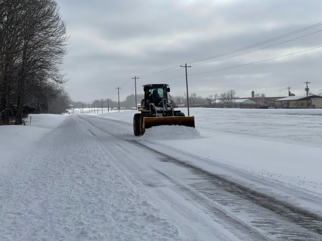 A snow plow clears a road Feb. 14 at Fort Campbell. The garrison team, specifically Directorate of Public Works, Directorate of Plans, Training, Mobilization and Securty, and the Directorate of Emergency Ser-vices, have shouldered the lion's share of the responsibility for the preparation and in the execution of the severe weather plan on Fort Campbell, said Col. Jeremy D. Bell, Fort Campbell garrison command-er.