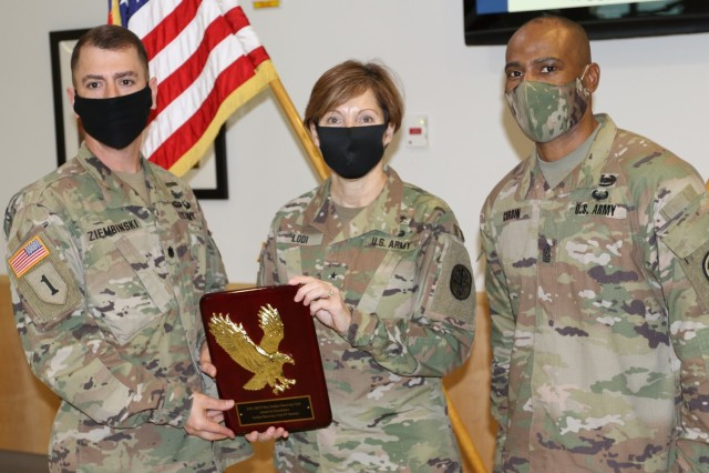 Regional Health Command-Atlantic Commander, Brig. Gen. Paula Lodi presented the award; which was received by the SRU commander Lt. Col. Edward Ziembinski (left) and SRU Command Sgt. Maj. Carlos Corbin (right), Jan. 27 on Fort Stewart.