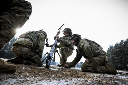 Paratroopers clean a 60mm mortar during a live-fire exercise at Grafenwoehr Training Area, Germany, Jan. 11, 2021.