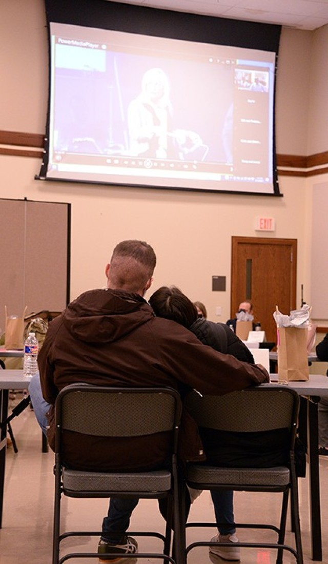 "Capt. Stephen Nitkowski, Command and General Staff Officer Course student, and his wife Emika Okada watch a video segment of ""Vertical Marriage: The One Secret That Will Change Your Marriage"" small-group study Feb. 12 at Frontier Chapel. Three couples met in person and several tuned in online for the first session of the study. Vertical Marriage continues March 5, April 9 and May 7 with in-person or virtual options to participate. Photo by Prudence Siebert/Fort Leavenworth Lamp"