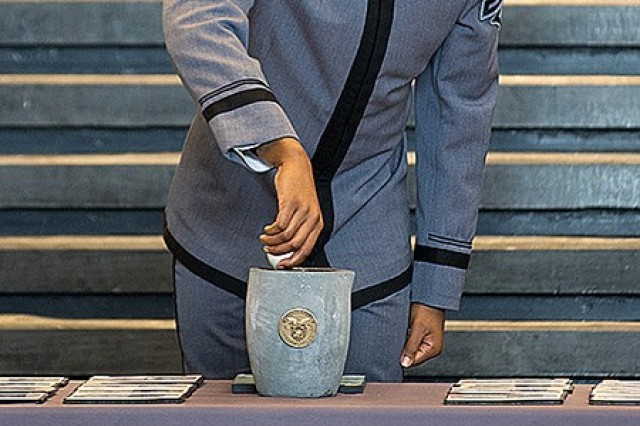 Members of the U.S. Military Academy Class of 2022 and distinguished guests participated in the 21st annual Association of Graduates' Ring Melt ceremony Friday at Eisenhower Hall's Crest Hall. The ceremony brought together several groups, including the U.S. Corps of Cadets, ring donor's friends and families who tuned in virtually and the Herff Jones Company, the company that makes the class rings. Class of 2022 Cadet and Class President Xavier Williams places a ring, one of 52 donated rings, in the crucible.