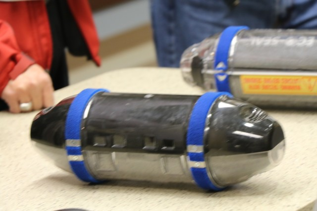A canister from the pneumatic tube system is displayed during a vendor fair held by William Beaumont Army Medical Center at the new facility, Jan. 11. The tube-linked system sends canisters to the receiving station, containing lab samples from various departments in the hospital.