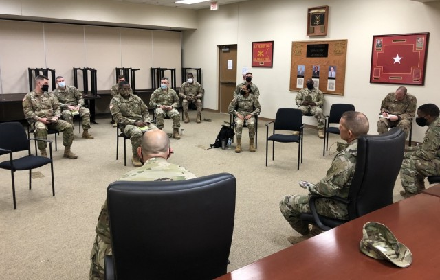 Sgt. Maj. of the Army Michael A. Grinston, lower right, has a discussion with a group of Soldiers in November 2020. Grinston spoke during a monthly Army Resilience Directorate webinar Feb. 17, 2021. He said that leaders at all levels need to take responsibility by educating themselves on the Army's standards toward sexual assault/harassment and take action when necessary.