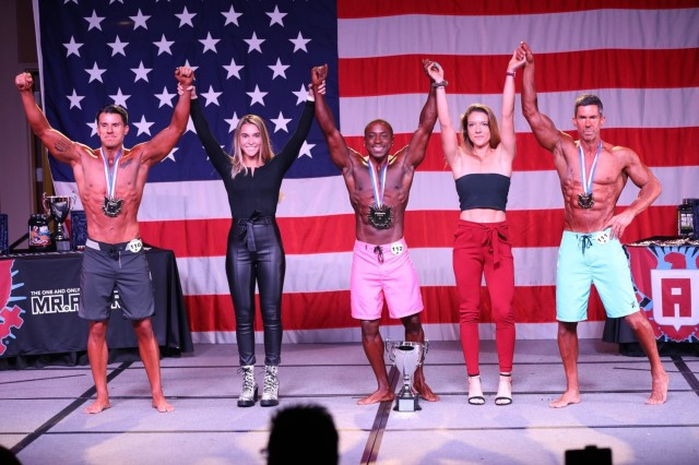 Capt. Johnny Dotson, (center), a social worker intern, with the Department of Social Work at William Beaumont Army Medical Center smiles after winning the Mr. America title last year.