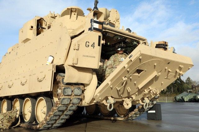 Soldiers don the Integrated Visual Augmentation System Capability Set 3 hardware while dismounting a Bradley in Joint Base Lewis-McCord, WA.