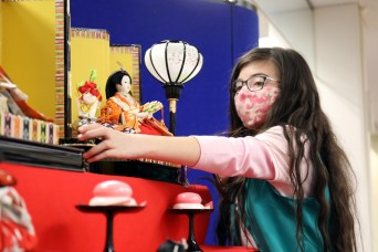 Camp Zama Girl Scouts set up doll display for Girls' Day in Japan