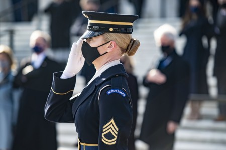 Army Sgt. 1st Class Chelsea Porterfield, sergeant of the guard at the Tomb of the Unknown Soldier, renders honors during a wreath-laying ceremony at Arlington National Cemetery, Va., Jan. 20, 2021.