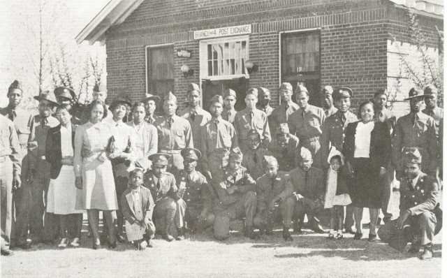 FORT BENNING, Ga. – Soldiers of the all-African American 24th Infantry Regiment and family members in 1941 outside the building here that housed the regiment's post exchange and snack bar. The building, which was across the street from the regiment's barracks, was built in 1937. Officials here will unveil a commemorative plaque at the site Feb. 24 during an observance of African American History Month, which will honor African American Soldiers who served at Fort Benning. The day is also scheduled to include a visit to the regiment's former theater, to the home once occupied by retired Gen. Colin L. Powell when he was a captain and major, and a renaming of a band hall in honor of the former 24th Infantry Regiment bandmaster, Chief Warrant Officer Robert B. Tresville Sr. Activated in 1869, the regiment served in the American West, and saw action on San Juan Hill during Spanish American War, and also served in Mexico, the Philippines, in World War II and the Korean War. It was stationed at Fort Benning from 1922 to April 1942.