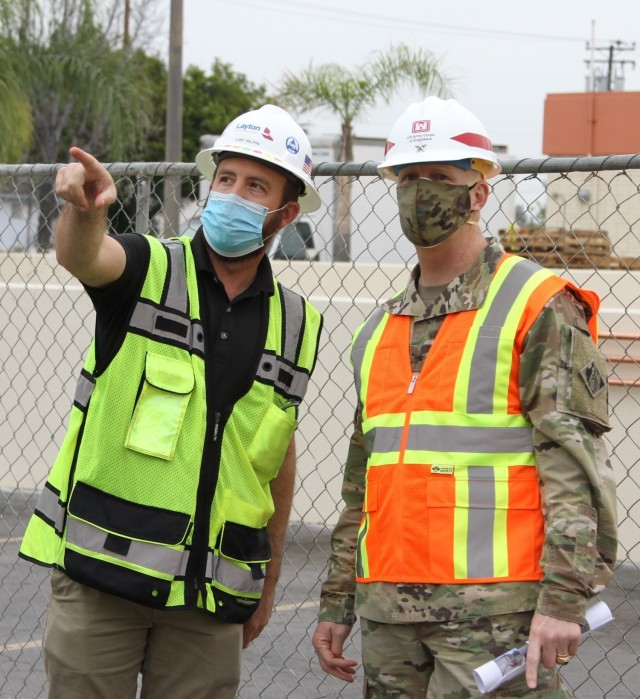 Luke Halpin, construction manager with Layton Construction Company, left, talks with Brig. Gen. Paul Owen, U.S. Army Corps of Engineers South Pacific Division commander, during Owen's Feb. 9, 2021, visit to Beverly Community Hospital in Montebello, California, to see construction progress there, including upgrades to a 17-bed wing in the facility for non-COVID patients and the conversion of a pre-operation waiting room to a COVID staging area through the addition of high-flow oxygen.
