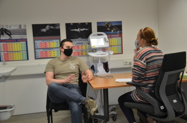 WIESBADEN, Germany—Staff Sgt. Geordyn Bryan with the 522nd Military Intelligence Battalion, is doing an intake interview with Autumn Feiring.  He came over to the AWC as a self-referral in order to improve his fitness level and increase his strength.
