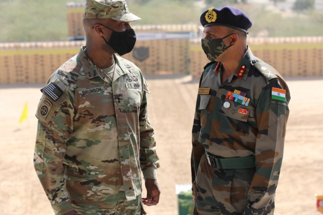 U.S. Army Maj. Gen. Xavier Brunson and Indian Army Maj. Gen. Michael AJ Fernandez speak at the conclusion of Exercise Yudh Abhyas, Feb. 21, 2021 in India. Now in its 16th year, Yudh Abhyas builds on the enduring Indian-U.S. partnership through 14 days of combined field training, cultural exchange and a brigade-level command post exercise, leading to greater interoperability between the two nations, in support of a free and open Indo-Pacific. (Photo by Staff Sgt. Joe Tolliver, 1-2 Stryker Brigade Combat Team public affairs)