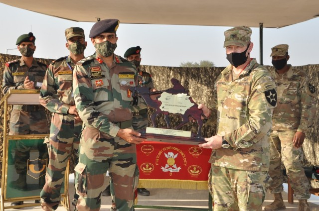 Commanders from the Indian Army's 170th Infantry Brigade and the U.S. Army's 1-2 Stryker Brigade exchange gifts during Yudh Abhyas, Feb. 19, 2021 in India. Now in its 16th year, Yudh Abhyas builds on the enduring Indian-U.S. partnership through 14 days of combined field training, cultural exchange and a brigade-level command post exercise, leading to greater interoperability between the two nations, in support of a free and open Indo-Pacific. (Photo courtesy of Indian Army)