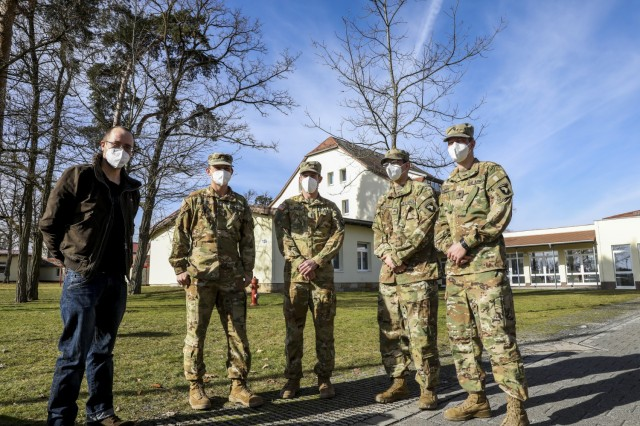 (From left to right) Joachim Strauch, a German who was treated by American Soldiers after being involved in a car crash, stands next to his rescuers; Maj. Benjamin Stork, Chief Warrant Officer 2 Robert Riedel, Sgt. Patrick Carter, and Spc. Bruce Cook, assigned to Bravo Company, 6th General Support Aviation Battalion, 101st Combat Aviation Brigade, during an awards ceremony recognizing the team for their efforts, Grafenwoehr, Germany, Feb. 18, 2021. Brig. Gen. Christopher Norrie, Commander, 7th Army Training Command, and Brig. Gen. Thomas Hambach, Commander, Landeskommando Bayern, were both present at the award ceremony to thank the crew for their heroic actions.