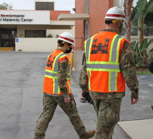 Col. Julie Balten, U.S. Army Corps of Engineers Los Angeles District commander, left, talks with Brig. Gen. Paul Owen, U.S. Army Corps of Engineers South Pacific Division commander, during Owen's Feb. 9, 2021 walk-through of Beverly Community Hospital to review early construction progress at the facility, including upgrades to a 17-bed wing in the facility for non-COVID patients and the conversion of a pre-operation waiting room to a COVID staging area through the addition of high-flow oxygen.