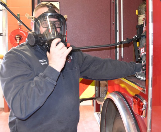 Mike Cantrell, firefighter, verifies that his equipment is in working condition Feb. 11, at the Rock Island Arsenal fire station during daily morning maintenance procedures.